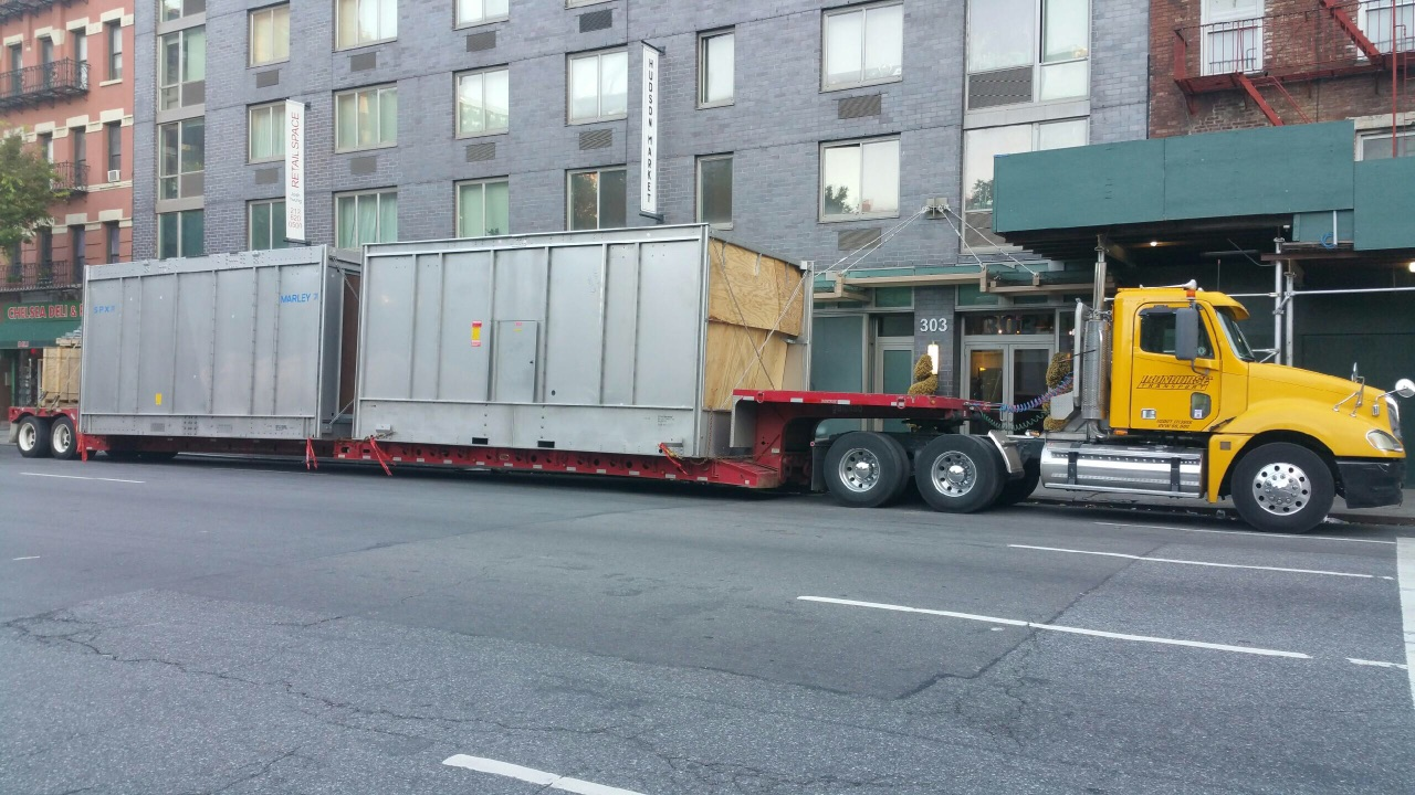 Iron Horse Transport truck carrying cargo through New York City