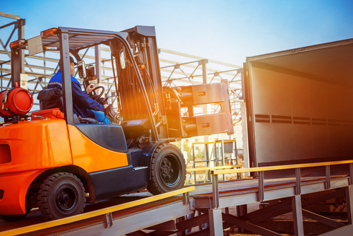 forklift driving into delivery truck