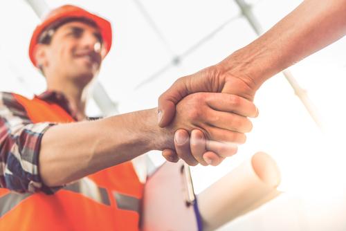 trucker construction worker shaking hands
